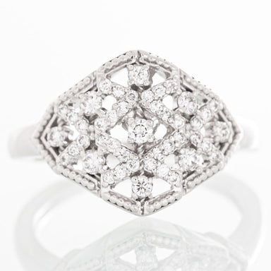 Beaded deco-style diamond ring in 14k white gold.