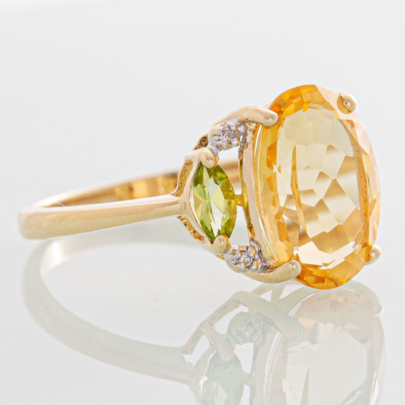 Sunrise Topaz with peridot and smokey diamonds in 14k gold.