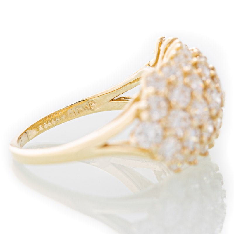 Diamond Bouquet ring in 18k yellow gold.