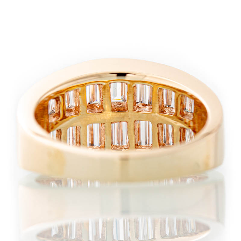 Story Baguette diamond ring in 14k gold.