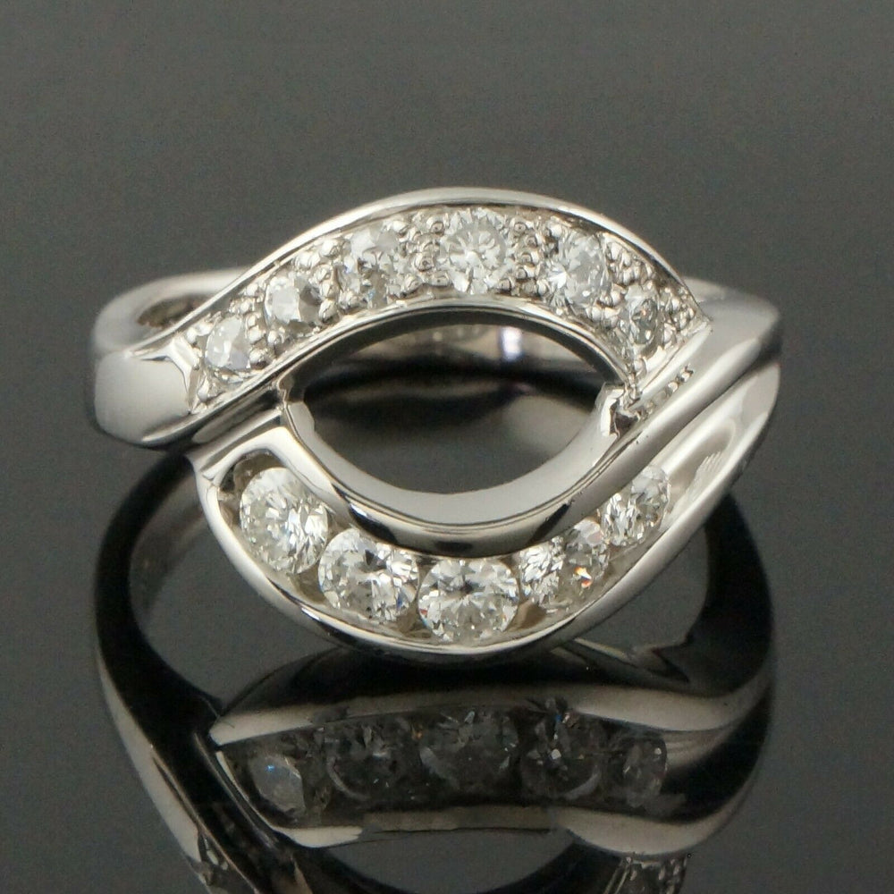 M. Devlin Platinum & .74 CTTW Diamond, Modernist Bypass Estate Ring