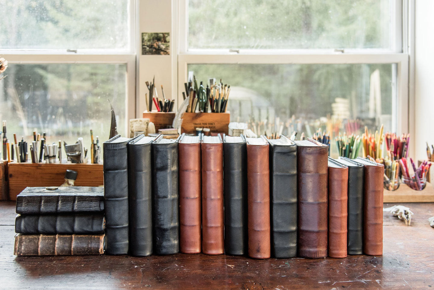 Handbound leather tome journals by Peg and Awl