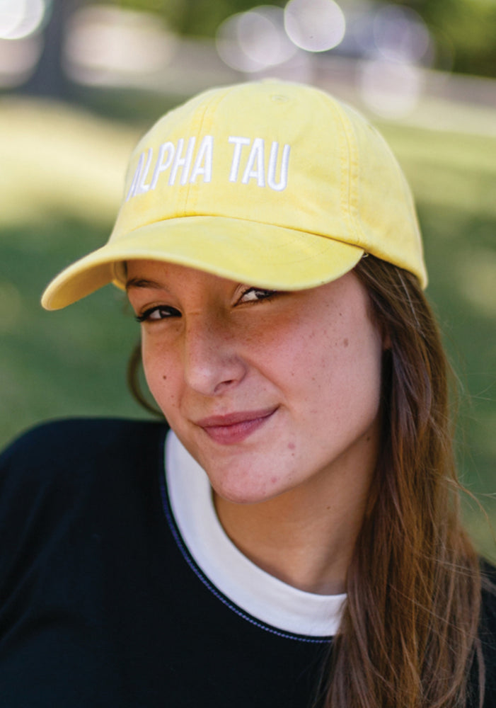 Yellow Alpha Tau Trucker Hat