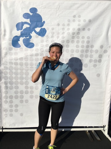 Olivia Wong and her well deserved medal after completing Disneyland's Star Wars Half Marathon