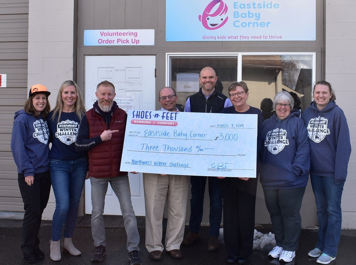 Donation check delivered to Eatside Baby Corner in 2019.