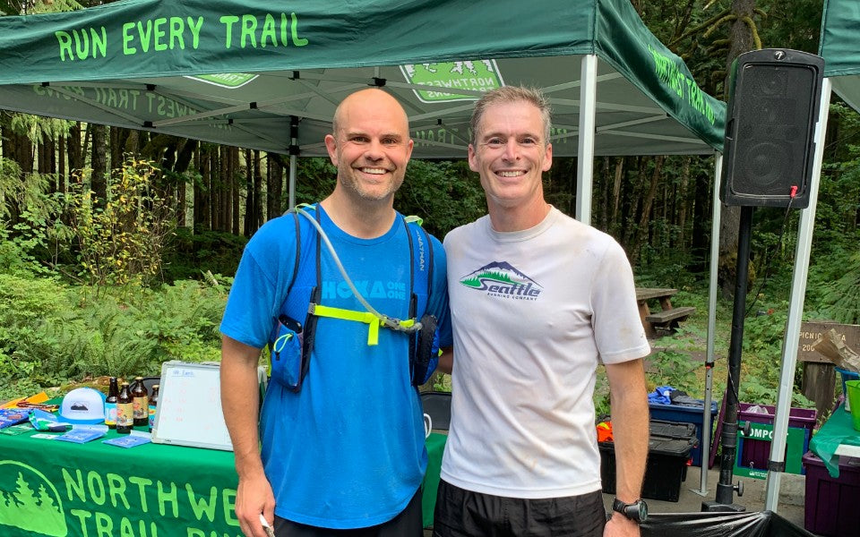 SHOES-n-FEET owner Chris Bentvelzen stands alongside Northwest Trail Runs company owner Eric Bone during Northwest Trail Runs recent Middle Fork 50K.