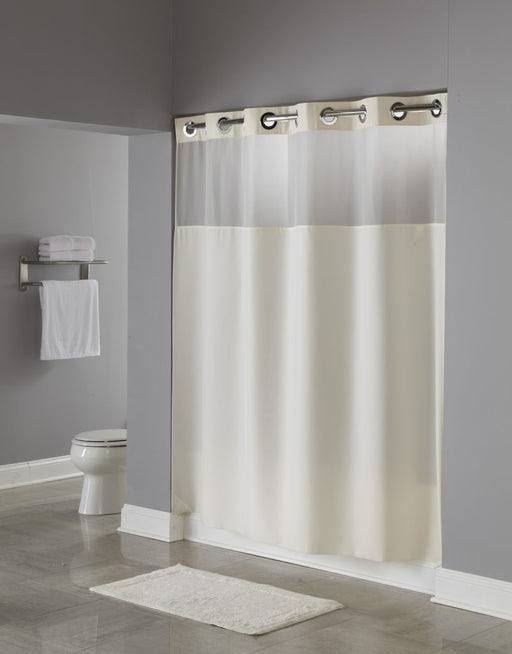 Illusion Hookless beige shower curtain with replaceable liner and translucent window. Polyester shower curtain with magnets. Price per dozen
