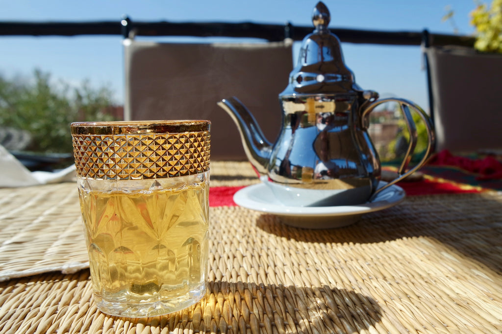 Fresh mint tea in Marrakech, poured from their icon silver teapots and served in decorative glassware