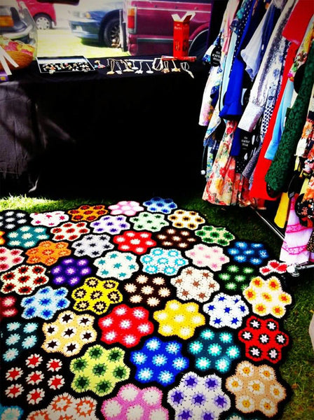 colorful quilt at the little big markets