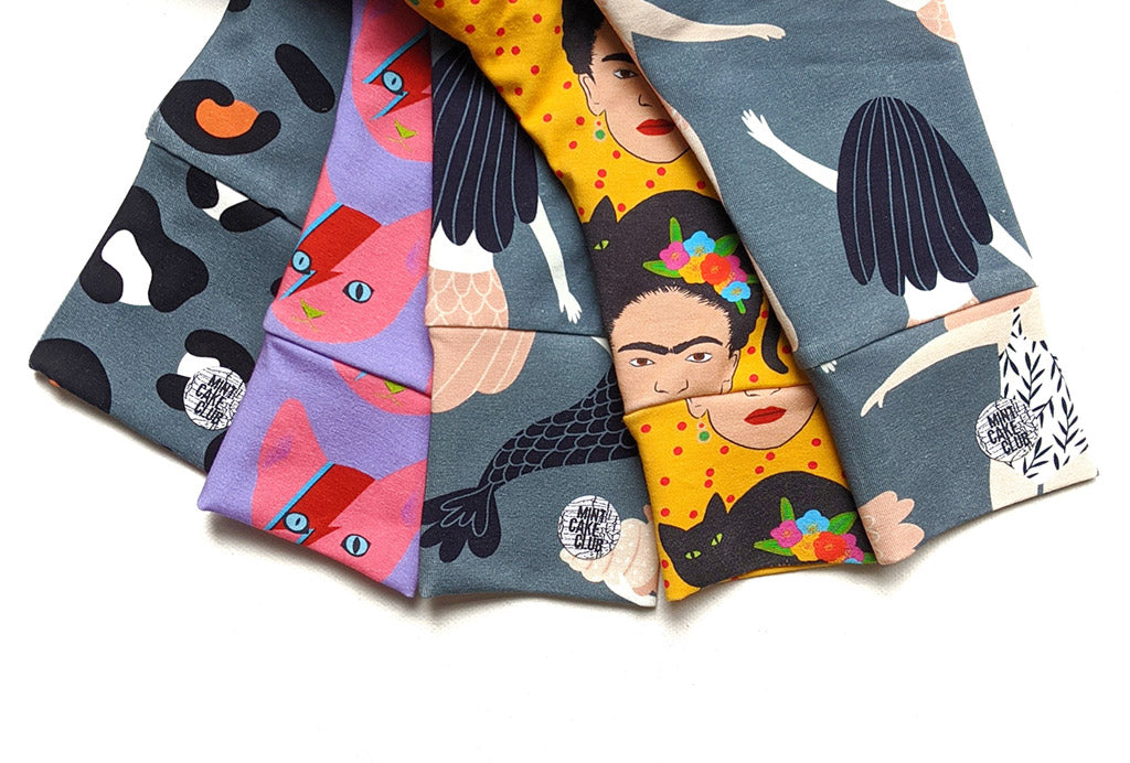 A pile of beautiful handmade children's leggings in gorgeous prints