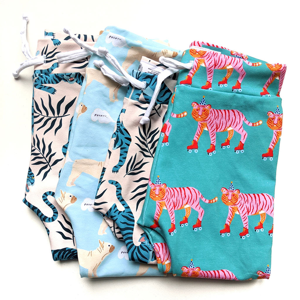 A pile of beautiful handmade children's leggings in gorgeous animal prints