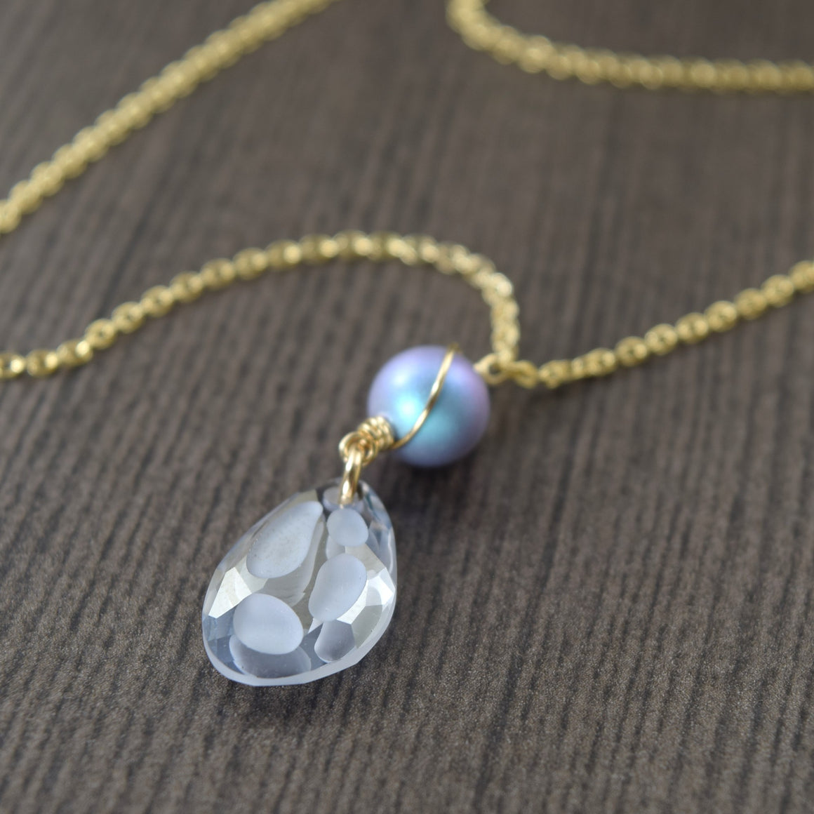 Light blue swarovski crystal butterfly wing with crystal pearl accent on gold filled chain