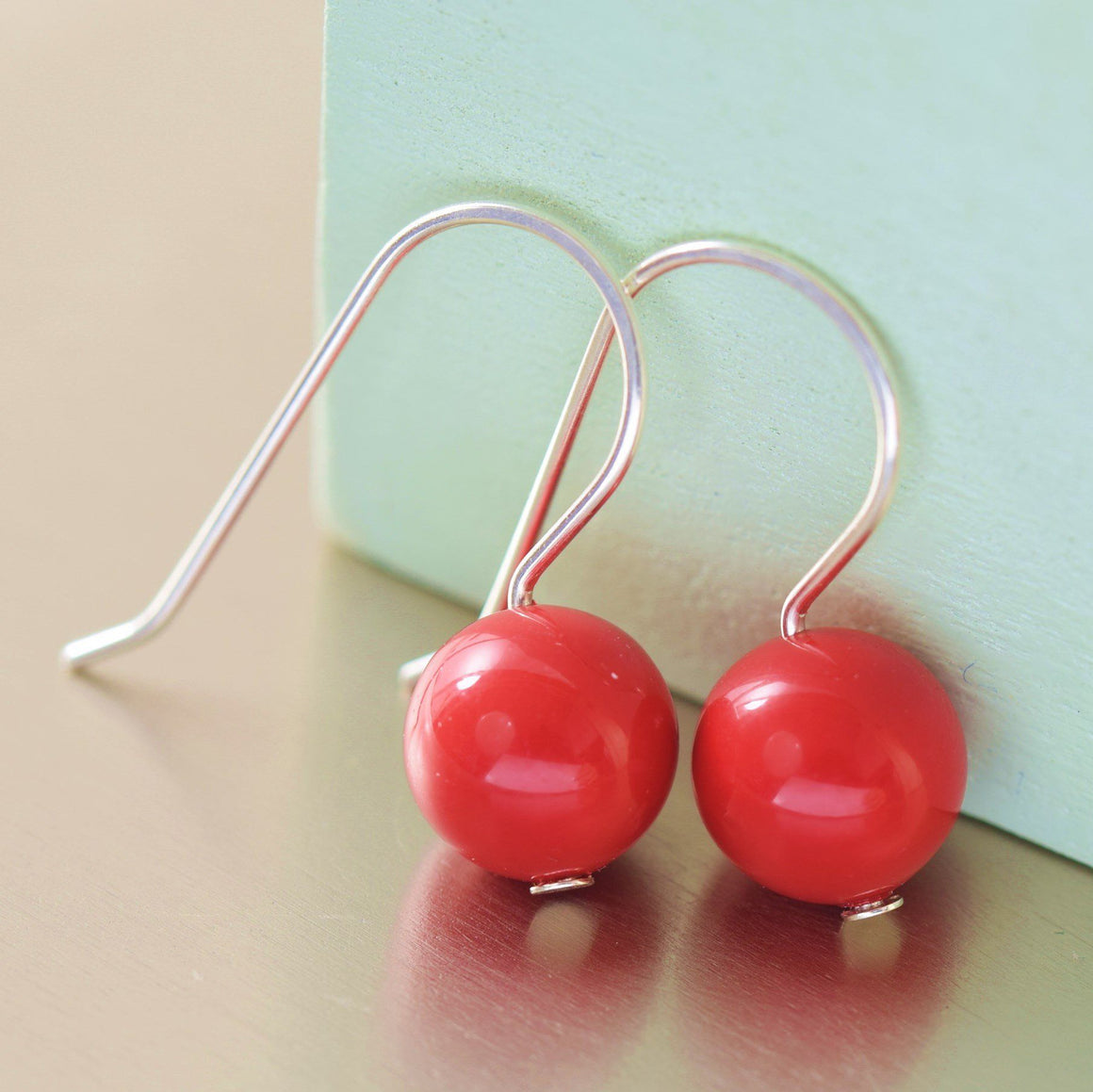 Red Swarovski pearl earrings in honor of American Heart Association