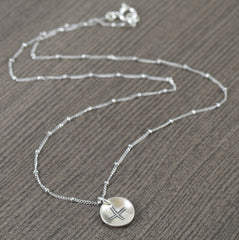 Unisex sterling silver necklace featuring a modern norse inspired cross