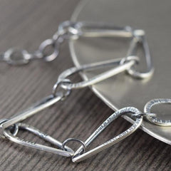 Statement bracelet with hammered teardrop blackened sterling silver links hand fabricated silver bracelet