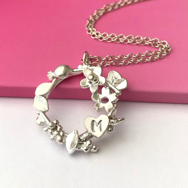botanical wreath with initial heart neckalce