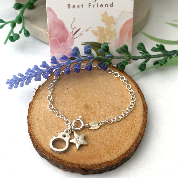 handcuff and initial star bracelet
