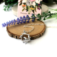 bird and nest necklace