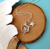 robin necklace with initial star