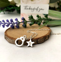 handcuff and initial star necklace