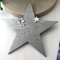 cluster star initial star earrings