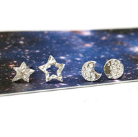 mismatched moon and star earrings