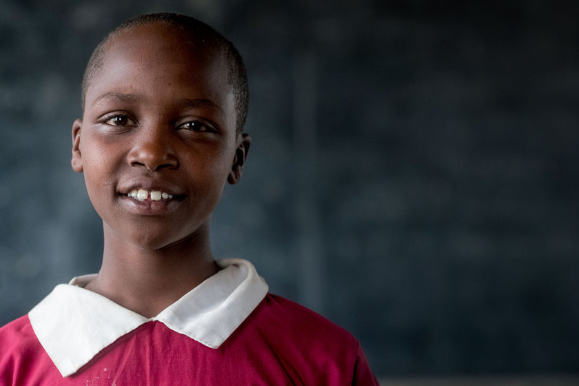 Your gifts will transform lives, like this girl who is in school because of you.