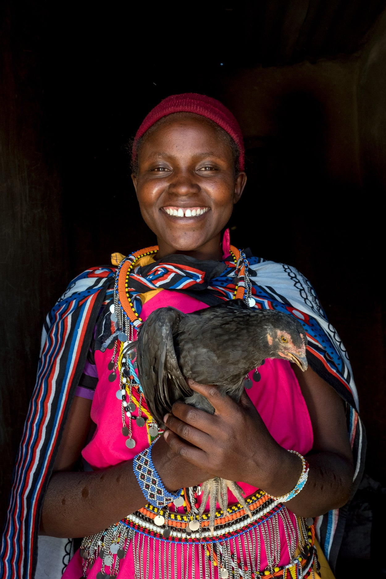 A girl holds a chicken.