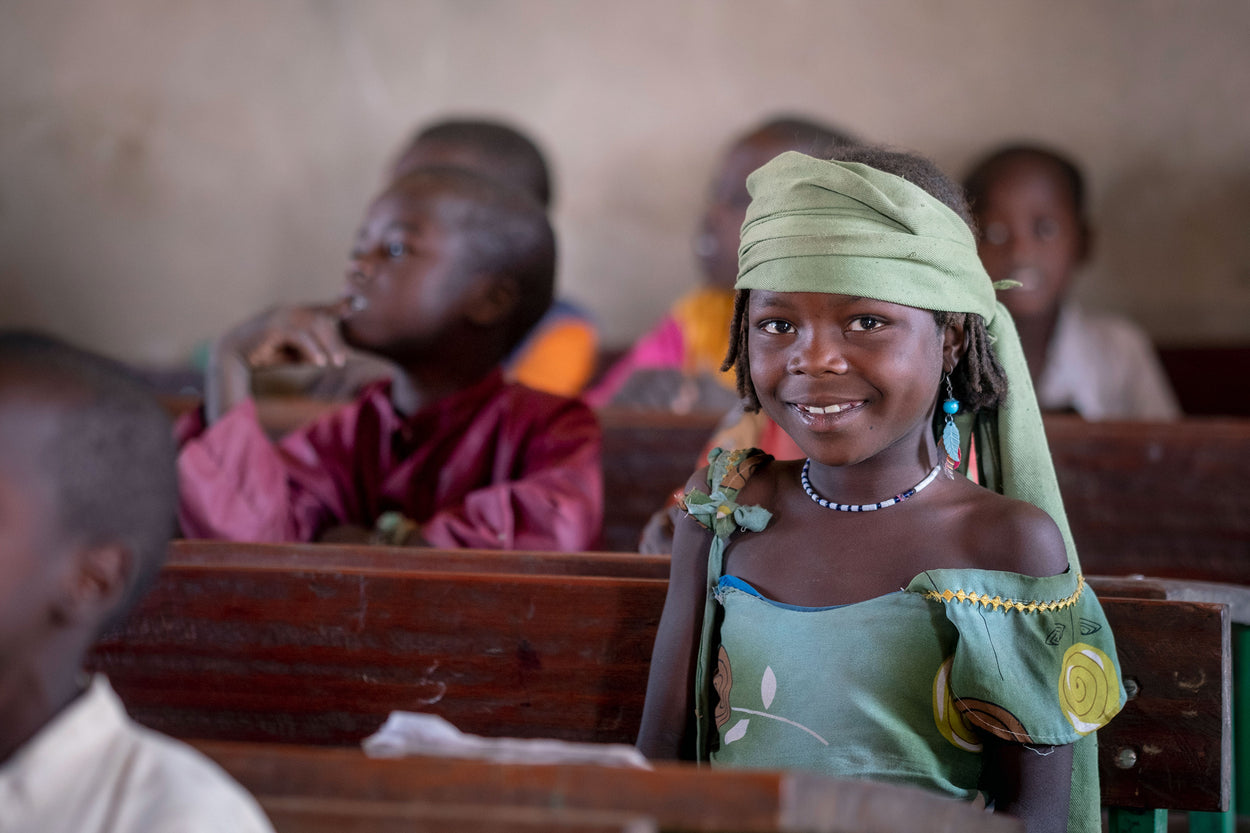 A young girl smiles as she attends school in Mara Mara, Chad.