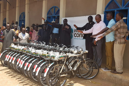 Evangelists pray over bicycles to help them spread the Good News