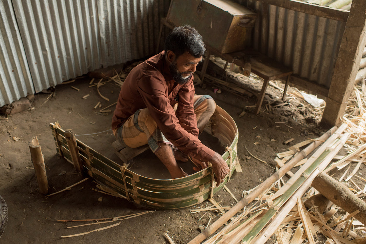 a man building part of a rickshaw