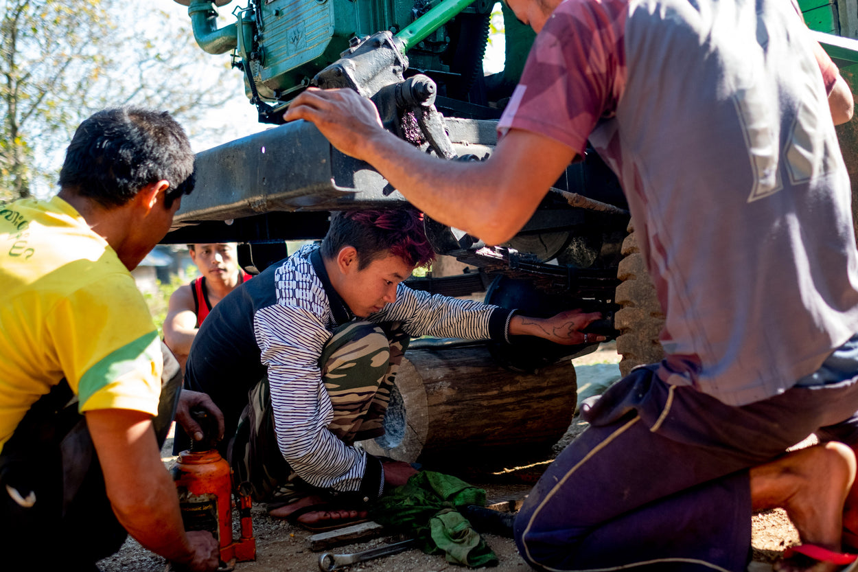 Teenage boys learn how repair machines to provide them an income.