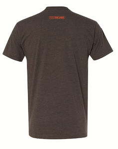 The back of a brown short sleeve fishing t-shirt with an orange logo near the collar.