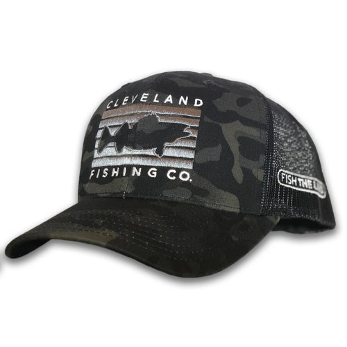 A black camo hat with black mesh back and rectangle with a fish in the middle and Cleveland Fishing Co. on the outside. Fish The Land logo on the side.