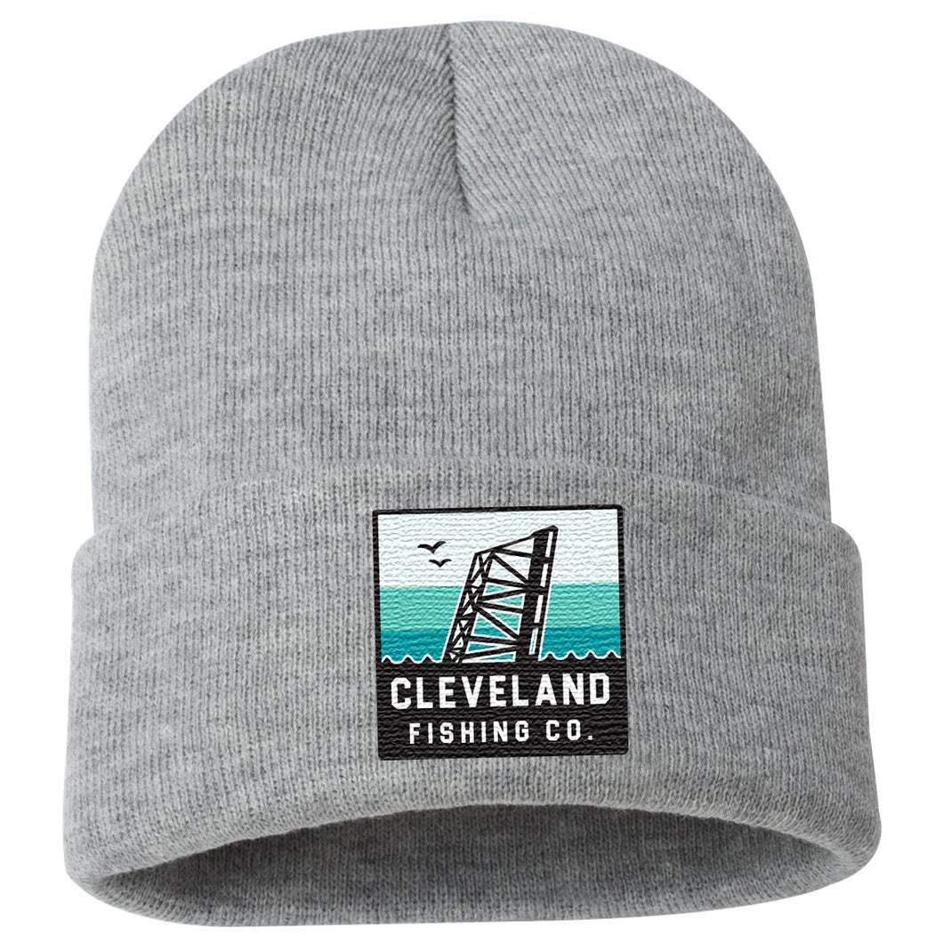 Grey winter hat with Cleveland Fishing Company bridge logo on the front center cuff
