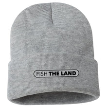 Grey winter hat with black Fish The Land logo on the center of the cuff