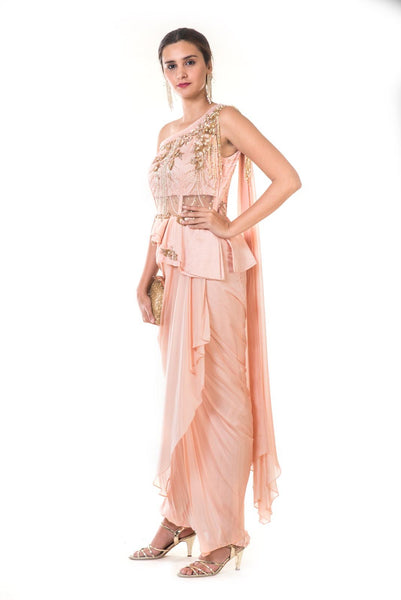 Pearl Pink Drape Gown with Heavy Hand Embroidered Peplum Bustier with An Attached One Side Dupatta and Fringes