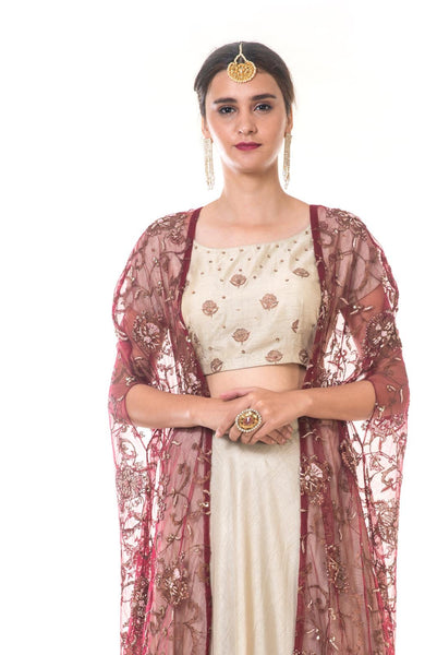 Hand Embroidered Blouse & Ruffle Lehenga Set with a Heavy Embroidered Tasselled Cape