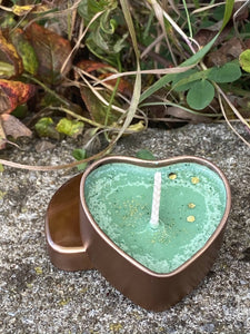 Heart shaped soya wax candle in tin.
