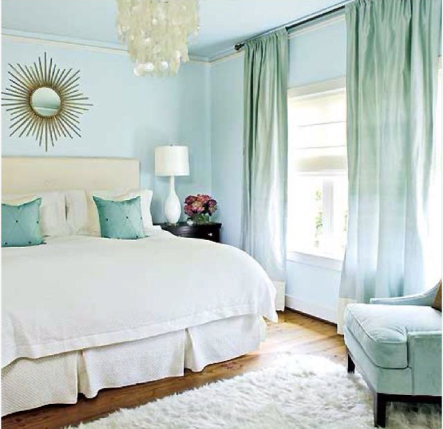 Blue bedroom via thebudgetdecorator.com. A simple coat of paint can transform an interior. Using eco-friendly, low VOC paint keeps the earth happy about your new color scheme.