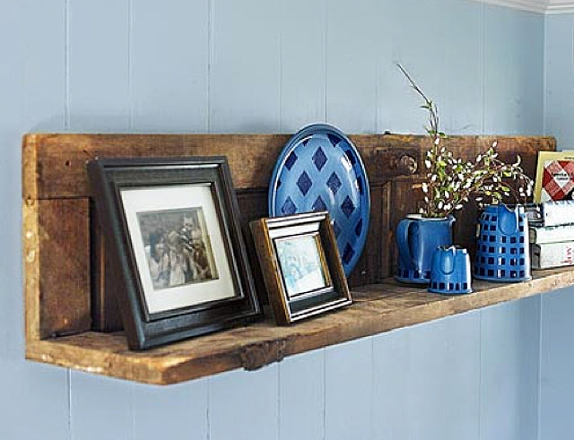 Photo copyright Lindsley Rogers/Appleseed Photography This project, found on This Old House, shows an old farmhouse door sawn in half and attached with L-brackets to make a shelf. The original hinges and the original knob were left in place as a nod to its history.
