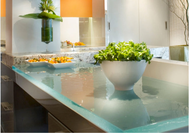 Photo copyright ThinkGlass. A glass countertop literally glows when the light hits it. This one, by ThinkGlass, a company that uses recycled glass is a stunning example.