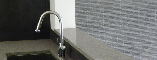 Image of the grey countertop with the grey wall in the background.