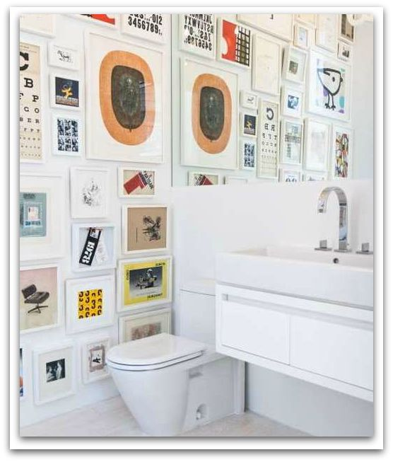 A white bathroom is the perfect blank canvas for your own powder room art gallery