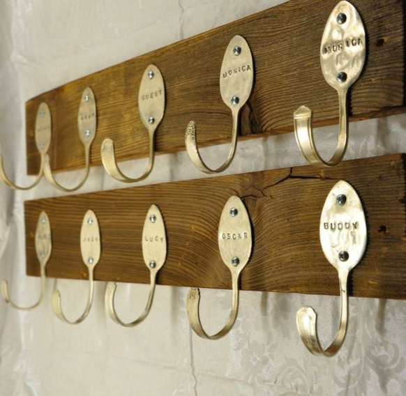 This idea, found on Pinterest, is one of the most delightful do-it-yourself projects that I have seen in a long time: old silver spoons that were flattened, bent, hand stamped with family names and turned into a personalized coat rack. Brilliant. Photo found on Pinterest