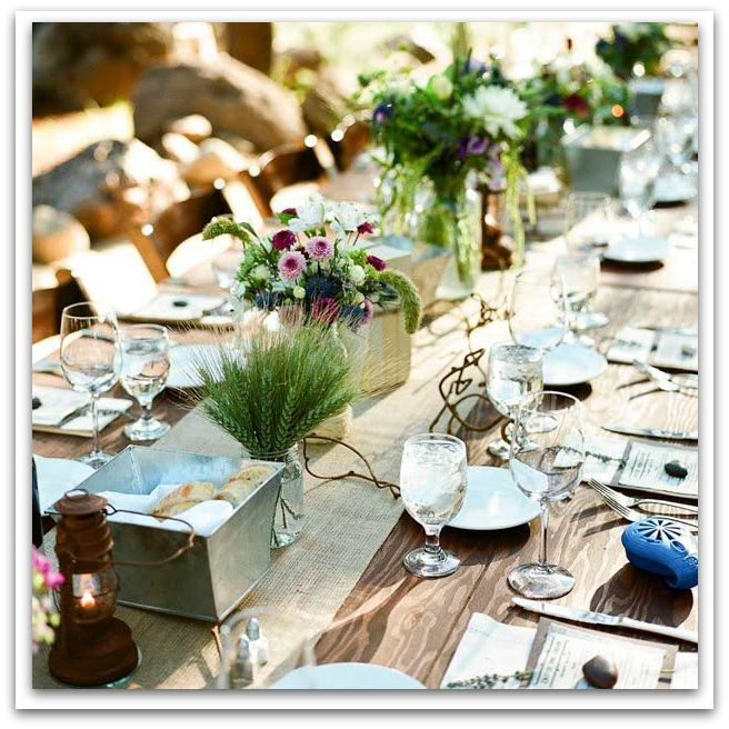 A burlap runner, tin bread baskets and wildflowers