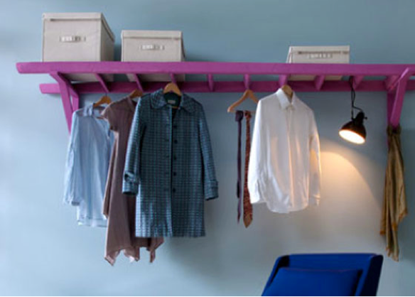 This clever use of a ladder turns it into a replacement for a clothing rack. The bright color is both bold and fun.
