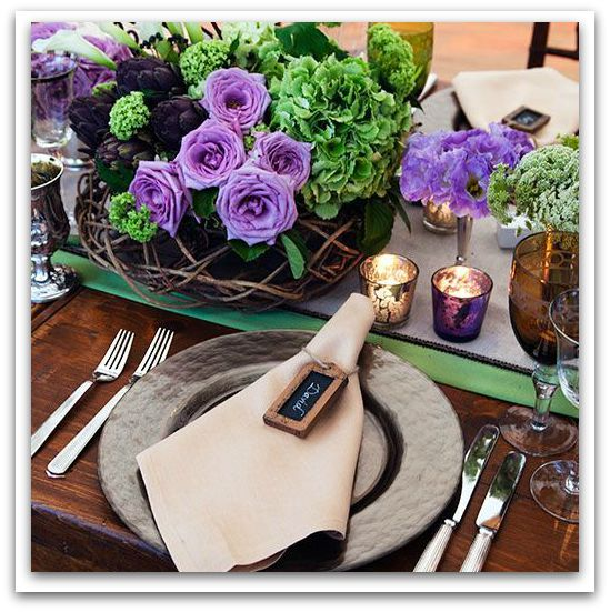 Floral beauty and sophisticated bronze dining accessories bring it home.