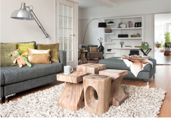 Photo found on Houseorhome.net The collection of rustic stools in the image above are collected together to replace a coffee table—and the result adds warmth and a personal touch to an otherwise very clean, modern living space.