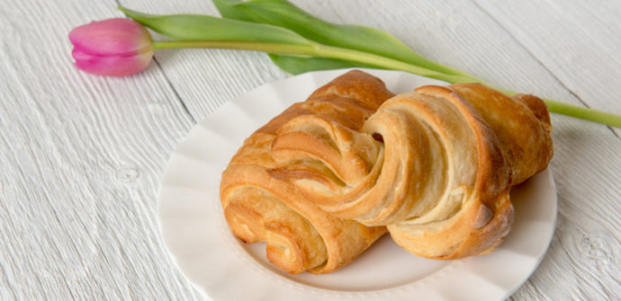 Croissants on plate with tulip in background